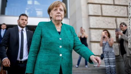 Merkel leaves the German parliament after a CDU leadership meeting Thursday.