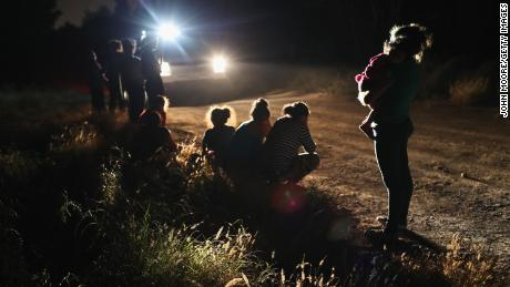"MCALLEN, TX - JUNE 12:  U.S. Border Patrol agents arrive to detain a group of Central American asylum seekers near the U.S.-Mexico border on June 12, 2018 in McAllen, Texas. The group of women and children had rafted across the Rio Grande from Mexico and were detained before being sent to a processing center for possible separation. Customs and Border Protection (CBP) is executing the Trump administration's ""zero tolerance"" policy towards undocumented immigrants. U.S. Attorney General Jeff Sessions also said that domestic and gang violence in immigrants' country of origin would no longer qualify them for political asylum status.  (Photo by John Moore/Getty Images)"