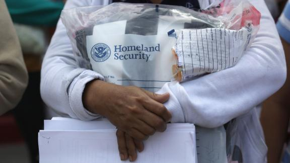 """MCALLEN, TX - JUNE 11:  Central American immigrants depart ICE custody, pending future immigration court hearings on June 11, 2018 in McAllen, Texas. Thousands of undocumented immigrants continue to cross into the U.S., despite the Trump administration's recent """"zero tolerance"""" approach to immigration policy.  (Photo by John Moore/Getty Images)"""