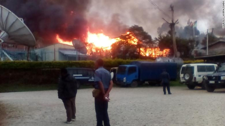 A building is seen on fire during riots in Papua New Guinea's Southern Highlands province.