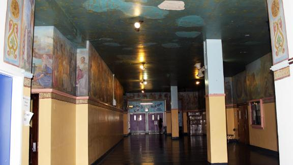 """The ceiling of a hallway at Dewitt Clinton High School before """"Constellations"""" was painted over"""