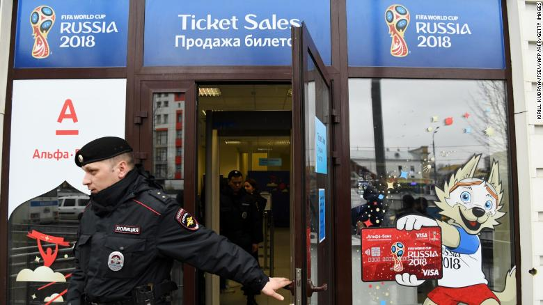 A Russian police officer leaves the newly opened FIFA main ticket office in central Moscow on April 18, 2018. Tickets including electronic tickets for the 2018 FIFA World Cup in Russia, will be on sale in this office from May 1, 2018. / AFP PHOTO / Kirill KUDRYAVTSEV        (Photo credit should read KIRILL KUDRYAVTSEV/AFP/Getty Images)