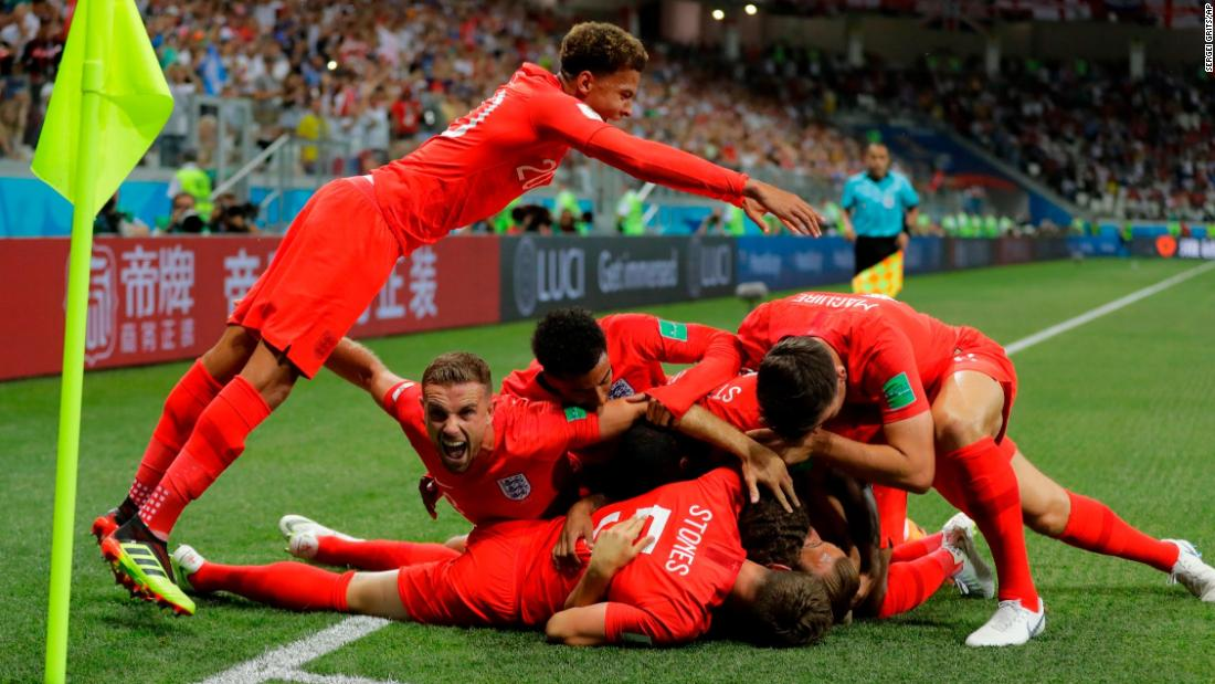 English players celebrate Harry Kane's first goal in the 2-1 win over Tunisia on Monday, June 18. Kane later added the winner in second-half stoppage time.