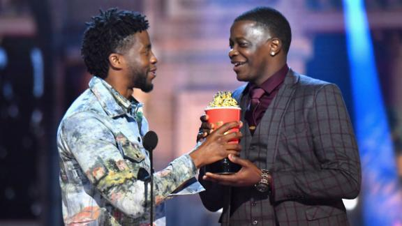 SANTA MONICA, CA - JUNE 16:  James Shaw Jr. accepts award from Actor Chadwick Boseman onstage at the 2018 MTV Movie And TV Awards at Barker Hangar on June 16, 2018 in Santa Monica, California.  (Photo by Jeff Kravitz/FilmMagic)