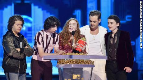 Gaten Matarazzo, Finn Wolfhard, Sadie Sink, Dacre Montgomery, and Noah Schnapp speak onstage at the 2018 MTV Movie & TV Awards