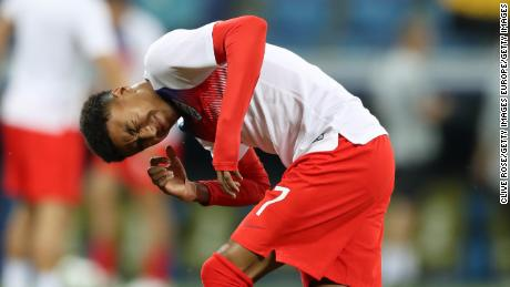 Jesse Lingard of England reacts after an insect lands on him ahead of the 2018 FIFA World Cup Russia group G match between Tunisia and England.