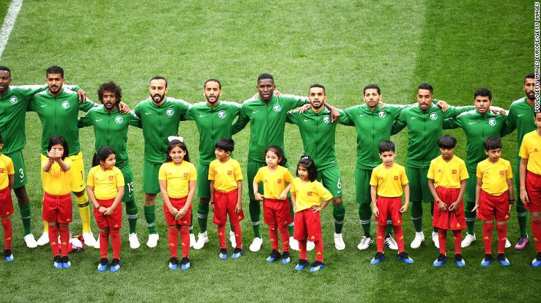 The Saudi Arabia squad sing their national anthem prior to the FIFA World Cup Russia Group A match between Russia and Saudi Arabia at Luzhniki Stadium on June 14, 2018 in Moscow, Russia.  (Photo by Pool/Getty Images)