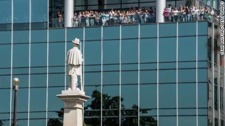 COLUMBIA, SC - JULY 10:  People watch from an office building as state law enforcement removes the Confederate battle flag from the South Carolina state house grounds July 10, 2015 in Columbia, SC. Yesterday, Governor Nikki Haley signed a bill ordering the removal of the flag from the capitol after the June murders at Emanuel AME Church in Charleston, South Carolina. (Photo by Sean Rayford/Getty Images)