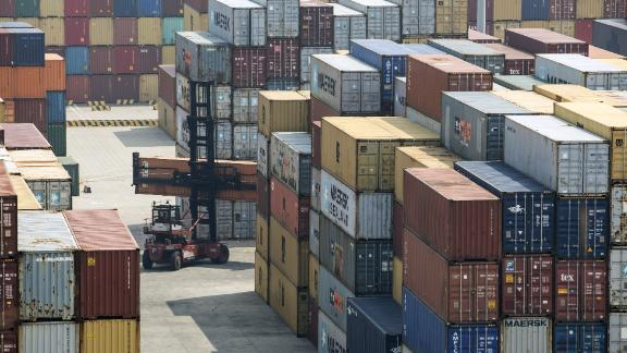 A reach stacker transports a shipping container in a terminal at the Yangshan Deep Water Port in Shanghai, China, on Friday, March 23, 2018. The trade conflict between China and the U.S. escalated, with Beijing announcing its first retaliation against metals levies hours after President Donald Trump outlined fresh tariffs on $50 billion of Chinese imports and pledged there