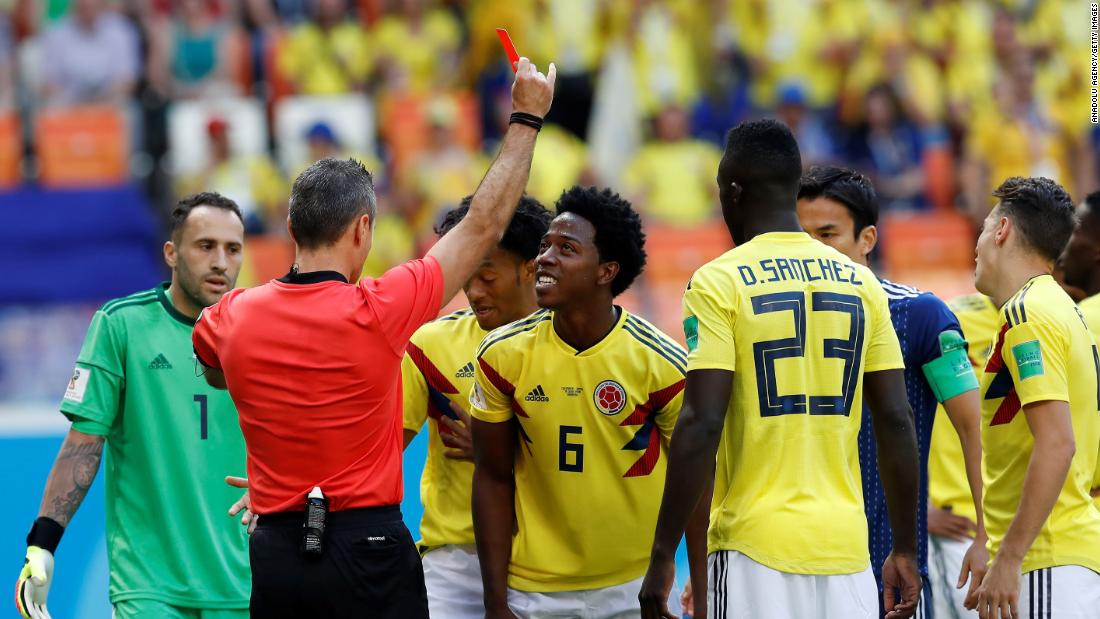 The referee shows a red card to Colombia's Carlos Sanchez in the third minute. Sanchez was deemed to have deliberately handled the ball in the box.
