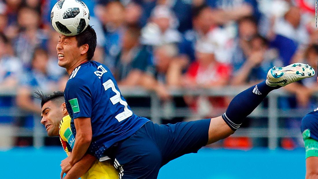 Japanese defender Gen Shoji climbs over Colombia's Radamel Falcao to win a header in their World Cup opener on Tuesday. Japan won the match 2-1.