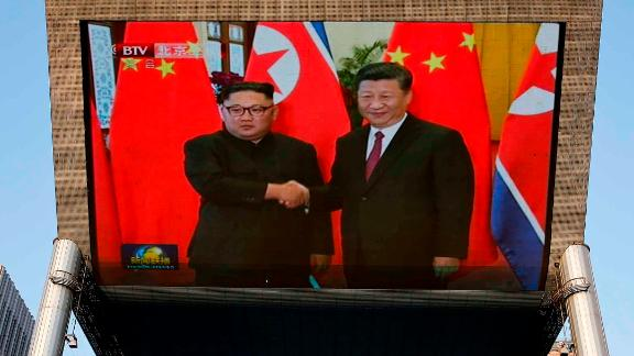 A giant TV screen broadcasting the meeting of Kim Jong Un and Xi Jinping on Tuesday.