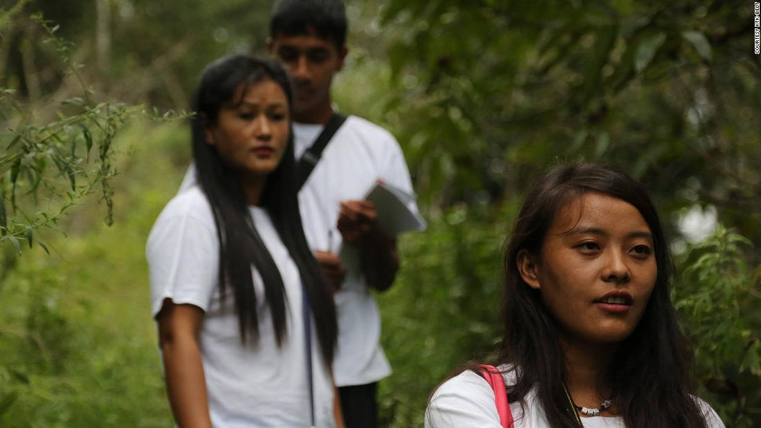 Ganga Limbu (front) is a youth fellow for Vertical University. Since beginning work for the project three years ago, she has been trained in conservation, filming, computing and design.