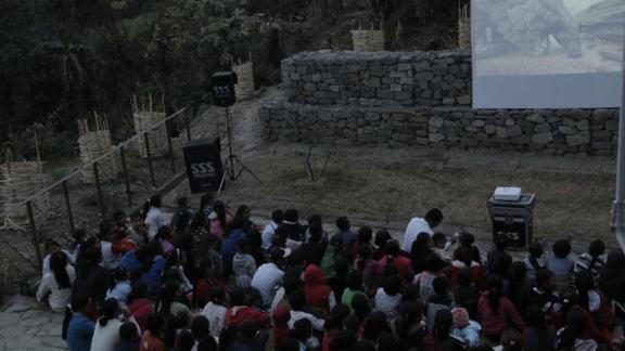 Vertical University often puts on cinema nights for rural communities, showing films that aim to raise environmental awareness. Here they showed a documentary on pangolins in Yangshila.