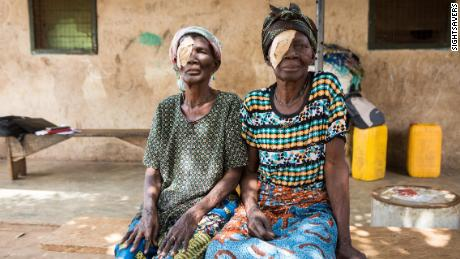 Barikisu Mohammed and her sister, Ayishetu Abdulai, in Yendi, Ghana, after eye surgery to treat trachoma infection and resulting scarring.