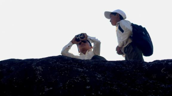 Students birdwatching during the outdoor education program