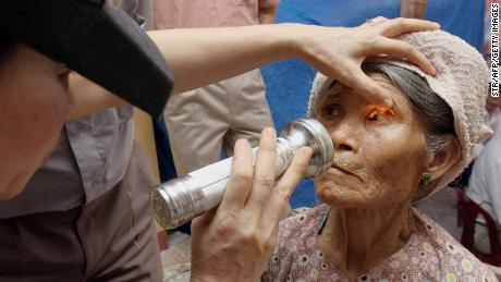 A farmer receives an examination for trachoma at a medical center in Vietnam, one of many countries aiming to eliminate the disease.