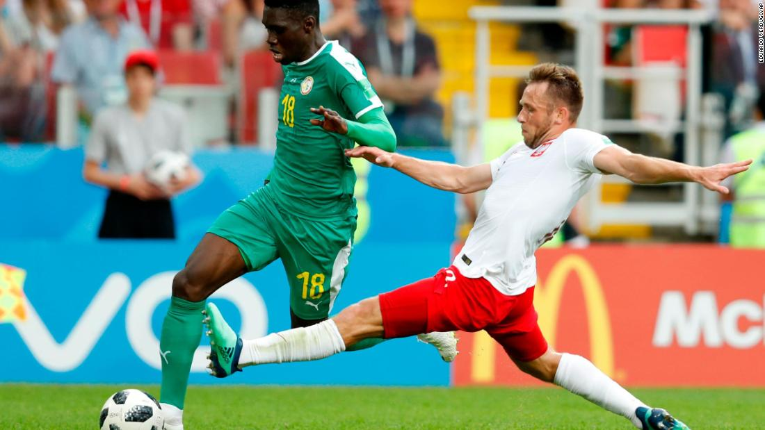 Senegal's Ismaila Sarr is tackled by Maciej Rybus.