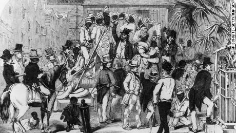 circa 1860:  Slaves being sold at Charleston, South Carolina. Original Artwork: Engraving by Eyrecrowe.  (Photo by Rischgitz/Getty Images)