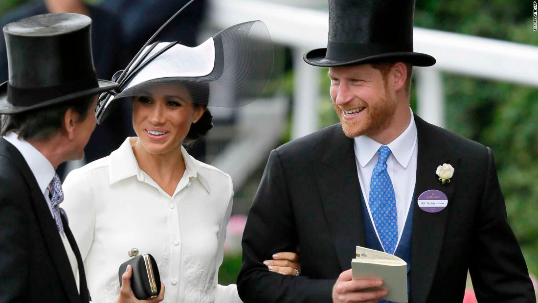 Harry and Meghan were all smiles as they arrived at the iconic Berkshire racecourse.