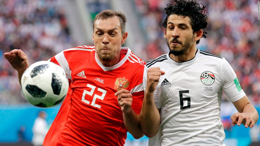 Russia's Artem Dzyuba, left, goes shoulder to shoulder with Egypt's Ahmed Hegazy during Russia's 3-1 victory on Tuesday, June 18.