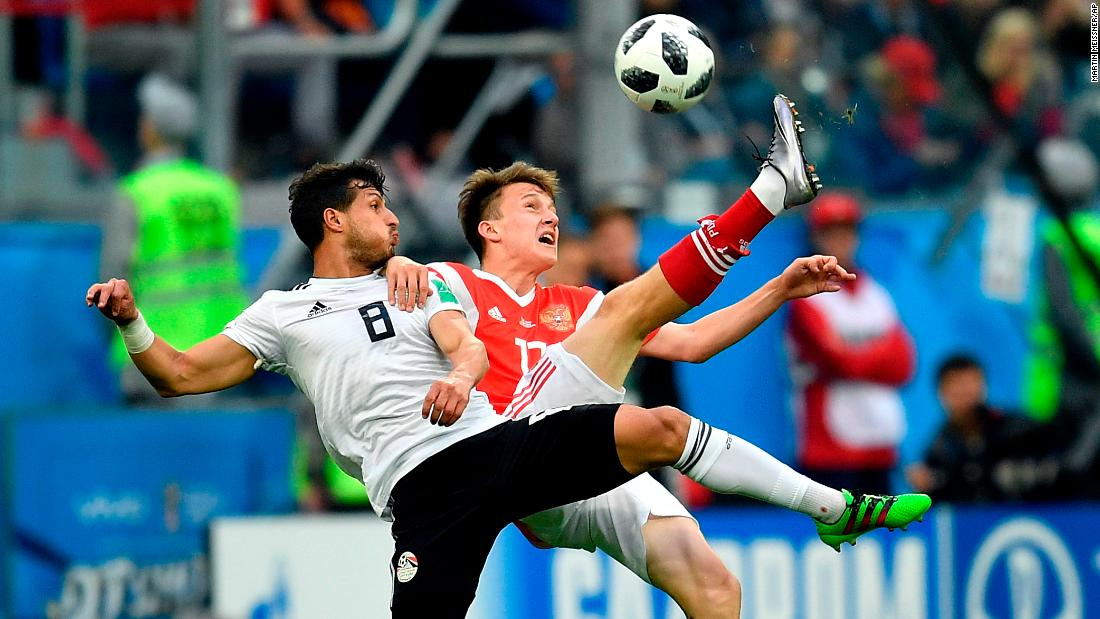 Egypt's Tarek Hamed, left, and Russia's Aleksandr Golovin compete for the ball.