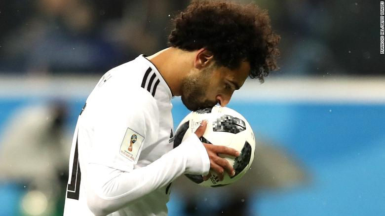 Mohamed Salah of Egypt kisses the ball before scoring from the penalty spot during the 2018 FIFA World Cup.