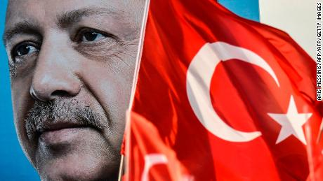 Turkish flags flutter nest to a huge portrait of Turkey's President and leader of the Justice and Development Party (AKP) Recep Tayyip Erdogan as he gives a speech during an AKP pre-election rally in Yenikapi Square in Istanbul on June 17, 2018. - With a week to go to crucial Turkish elections, the leader of the AKP  and his main rival of the secular Republican People's Party (CHP) are trading blows in an unexpectedly bruising fight to win control of the country. (Photo by Aris MESSINIS / AFP)        (Photo credit should read ARIS MESSINIS/AFP/Getty Images)