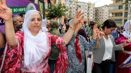 Candidates and supporters dance at the headquarters of the pro-Kurdish HDP party in Diyarbakir on May 24.