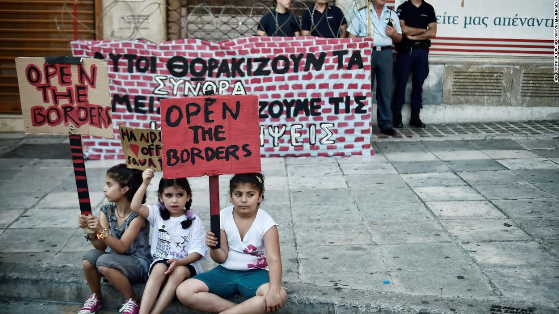 Refugee children in Athens call for safe routes out of Greece during a demonstration in June 2017.