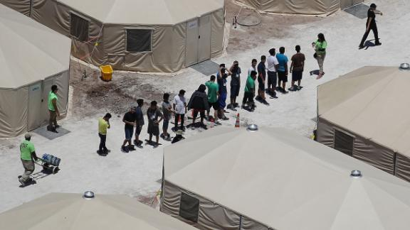 TORNILLO, TX - JUNE 19:  Children and workers are seen at a tent encampment recently built near the Tornillo Port of Entry on June 19, 2018 in Tornillo, Texas. The Trump administration is using the Tornillo tent facility to house immigrant children separated from their parents after they were caught entering the U.S. under the administration