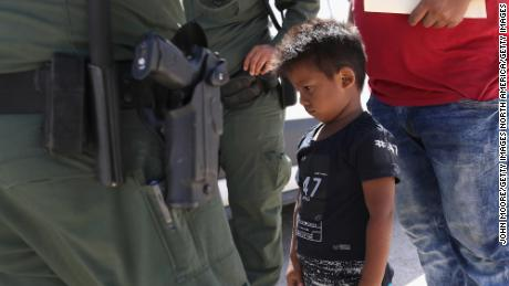 "MISSION, TX - JUNE 12:  A boy and father from Honduras are taken into custody by U.S. Border Patrol agents near the U.S.-Mexico Border on June 12, 2018 near Mission, Texas. The asylum seekers were then sent to a U.S. Customs and Border Protection (CBP) processing center for possible separation. U.S. border authorities are executing the Trump administration's ""zero tolerance"" policy towards undocumented immigrants. U.S. Attorney General Jeff Sessions also said that domestic and gang violence in immigrants' country of origin would no longer qualify them for political asylum status.  (Photo by John Moore/Getty Images)"