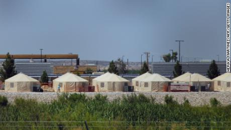 "View of a temporary detention centre for illegal underage immigrants in Tornillo, Texas, US near the Mexico-US border, as seen from Valle de Juarez, in Chihuahua state, Mexico on June 18, 2018. - Mexico strongly condemned US President Donald Trump's administration Tuesday for its policy of separating immigrant children and parents detained after crossing the US-Mexican border, calling it ""inhuman."" Herika Martinez/AFP/Getty Images"