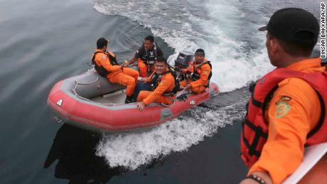 Indonesian rescuers search for a ferry which sank on Monday in Lake Toba, North Sumatra, Indonesia Wednesday, June, 20, 2018. Distraught relatives slammed Indonesia's government for not enforcing basic safety measures on passenger boats and pleaded Wednesday for a bigger search effort for the people missing since a ferry sank on a picturesque Sumatran lake early this week. (AP Photo/Binsar Bakkara)