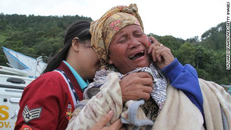 A woman cries as she finds out her family are listed as missing, at the Lake Toba ferry port in the province of North Sumatra on June 19, 2018, after a boat capsized the day before. - Search and rescue teams on June 19 were racing against time to search for 65 people after the boat capsized in Indonesia, an official from the disaster agency said. (Photo by LAZUARDY FAHMI / AFP) / The erroneous mention[s] appearing in the metadata of this photo by LAZUARDY FAHMI has been modified in AFP systems in the following manner: [adding date to caption]. Please immediately remove the erroneous mention[s] from all your online services and delete it (them) from your servers. If you have been authorized by AFP to distribute it (them) to third parties, please ensure that the same actions are carried out by them. Failure to promptly comply with these instructions will entail liability on your part for any continued or post notification usage. Therefore we thank you very much for all your attention and prompt action. We are sorry for the inconvenience this notification may cause and remain at your disposal for any further information you may require.        (Photo credit should read LAZUARDY FAHMI/AFP/Getty Images)