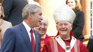 President George W. Bush stands with Cardinal Theodore McCarrick in 2005.