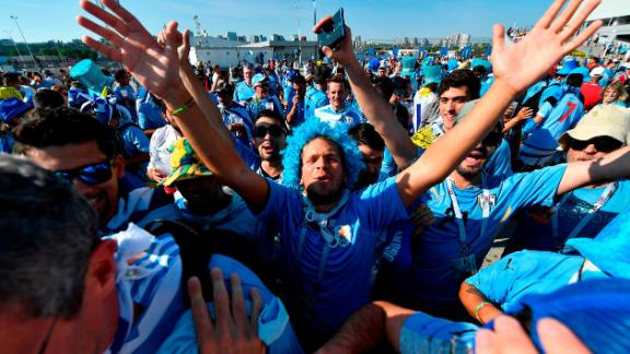 Uruguay fans cheer outside the stadium before the match with Saudi Arabia on June 20.