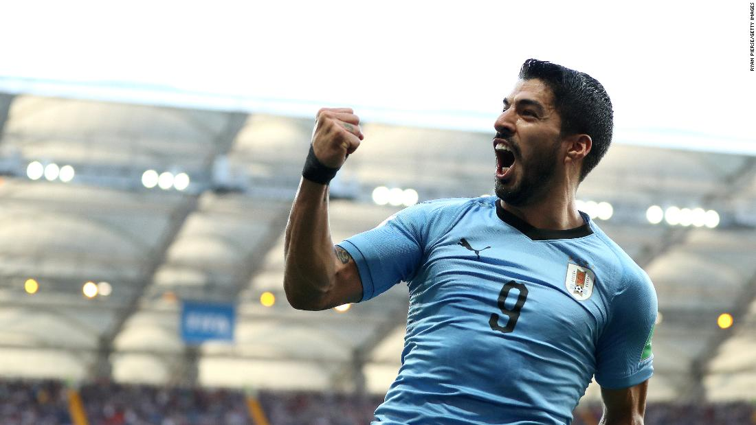 Luis Suarez celebrates after scoring for Uruguay in the 23rd minute. It was the only goal of the match, and the final result meant Uruguay and Russia would both advance to the tournament's knockout stage.