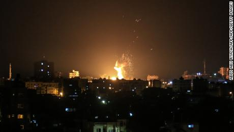 An explosion is seen in northern Gaza City after an airstrike by Israeli forces on June 20, 2018. - Israeli fighter jets hit 25 targets in the Gaza Strip early June 20 in response to rocket fire from the Palestinian territory, the army said. (Photo by ABED ABU RYASH / AFP)        (Photo credit should read ABED ABU RYASH/AFP/Getty Images)