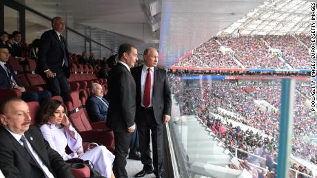 Putin and Prime Minister Dmitry Medvedev take part in the opening ceremony of the World Cup.