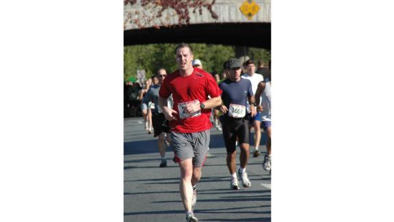 Justin Blazejewski running a marathon before an ankle injury left him unable to run long distances.