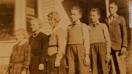 The Pieper children, from left, MaryAnn, Leona, Ivona, twins Ludwig and Julius, and Fred stand outside the family home in Nebraska in an undated family photo.