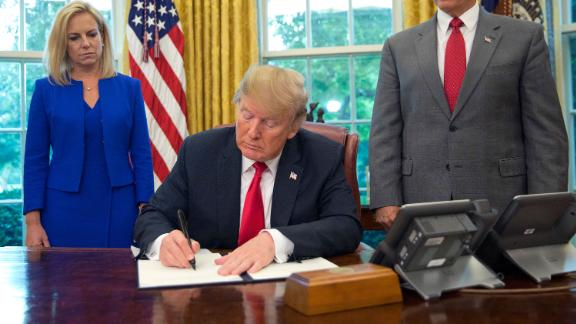 President Donald Trump signs an executive order to keep families together at the border, but says that the