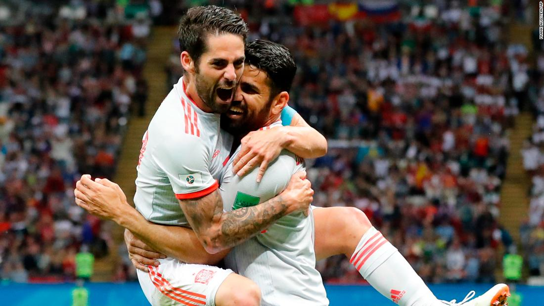 Spain's Diego Costa, right, celebrates with teammate Isco after scoring against Iran on Wednesday, June 20. Spain won 1-0.