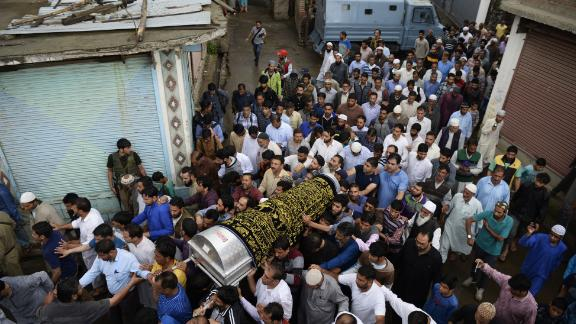 Kashmiri Muslims carry the coffin of Shujaat Bukhari, slain editor-in-chief of the Rising Kashmir  newspaper in Kreeri  on June 15, 2018.