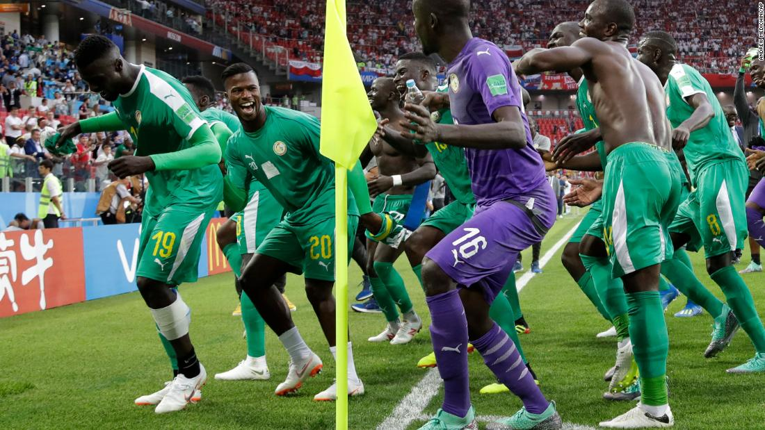 Members of the Senegal team celebrate after defeating Poland 2-1 in their match on Tuesday, June 19.