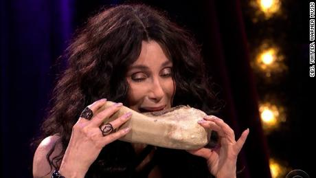 "Why would a question about President Trump prompt Cher to eat cow's tongue? CNN's Jeanne Moos reports.      Cher Eats Tongue   Cher eats COW tongue rather than answer a question about Donald Trump. Cher and Trump have a history of bad blood. She's always tweeting horrible things about him. Then James Corden put her on the spot in a segment of his show called Spill Your Guts or Fill Your Guts in which a celeb has to choose between answering a delicate question or eating some god awful dish like cow tongue. When Corden asked Cher to name one good thing about trump, Cher bit the bullet, or rather the tongue. This happened on Corden's show which is coming from Britain this week.  Will also include fab Carpool Karaoke of Corden and Paul McCartney singing ""Baby You Can Drive My Car."""