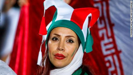 Am Iranian woman cheers for her national team during Wednesday's screening at Azadi Stadium.
