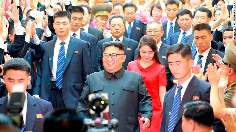 North Korean leader Kim Jong Un and his wife Ri Sol Ju arrive at North Korean Embassy in Beijing, June 20.