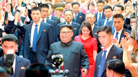 "In this Wednesday, June 20, 2018, photo provided on Thursday, June 21, 2018, by the North Korean government, North Korean leader Kim Jong Un, center, followed by his wife Ri Sol Ju, in red, arrives at North Korean Embassy in Beijing. Korean language watermark on image as provided by source reads: ""KCNA"" which is the abbreviation for Korean Central News Agency. (Korean Central News Agency/Korea News Service via AP)"